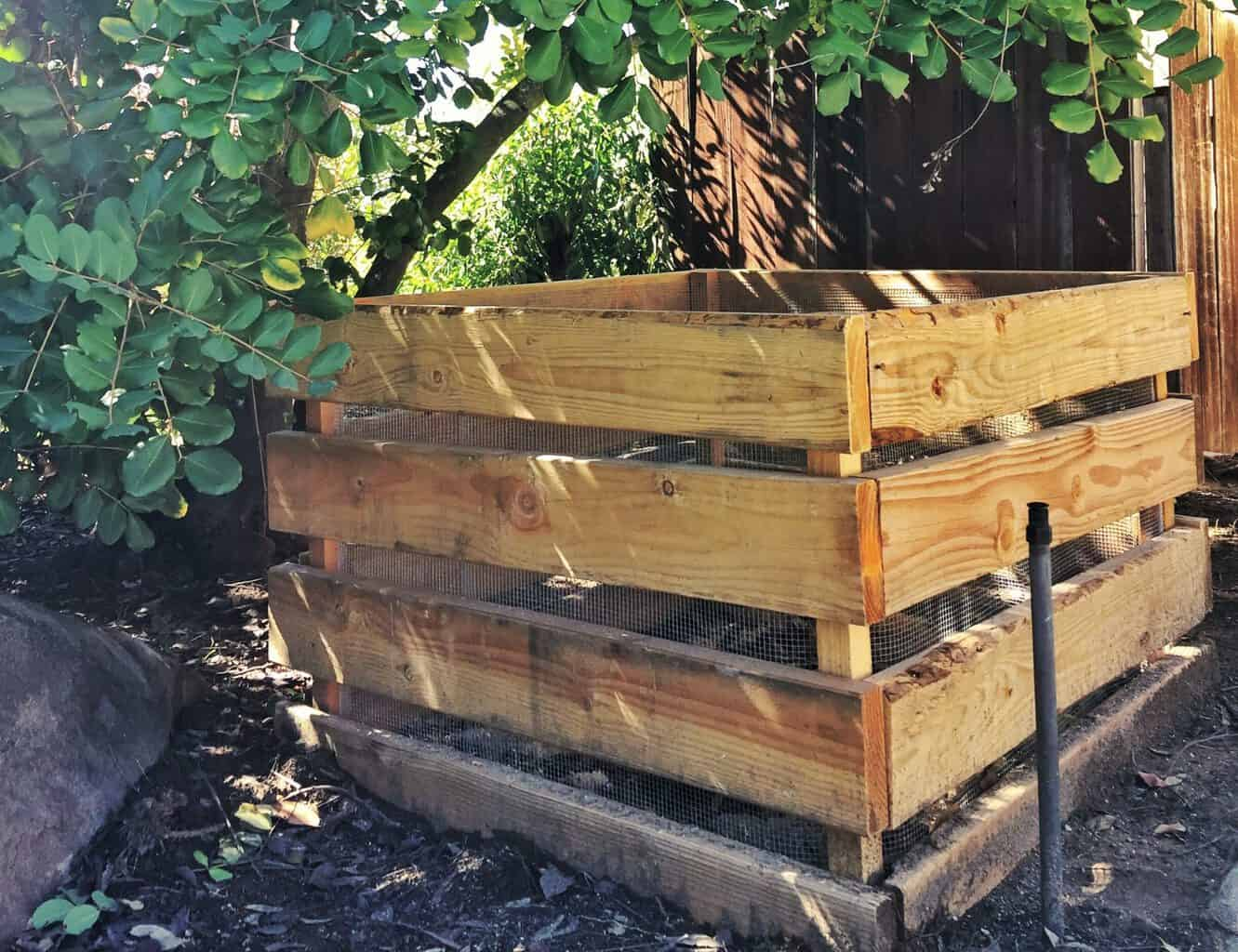 A completed home DIY compost bin in a yard