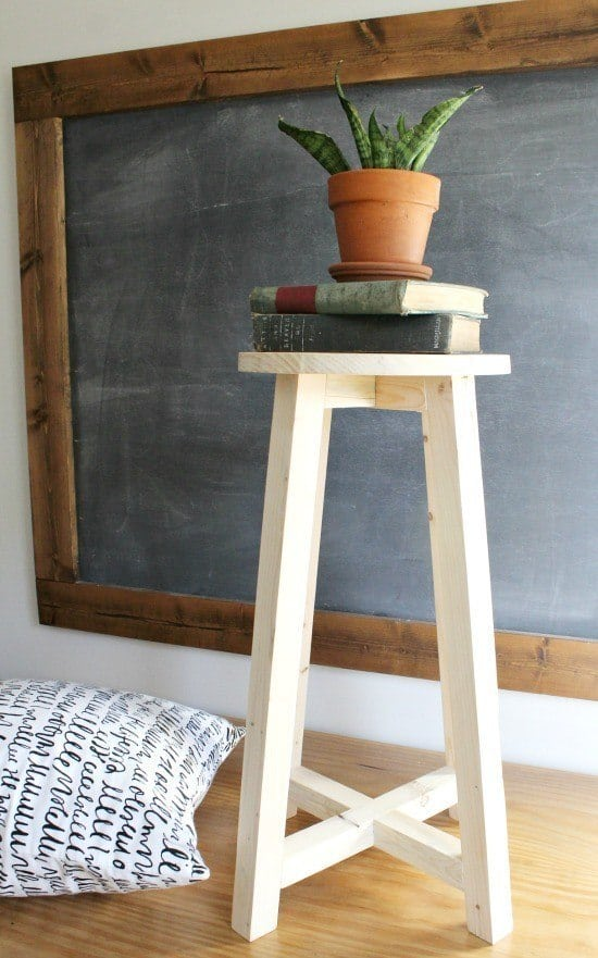 Plain wood bar stool with a plant