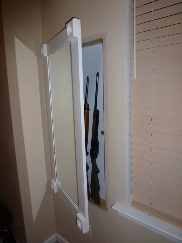Gun cabinet behind a frame