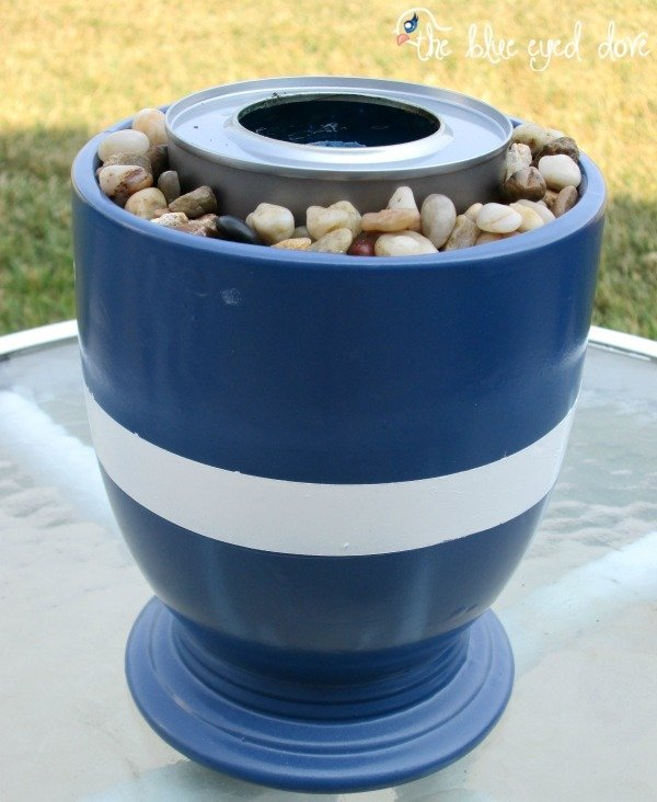 A blue and white stripe portable fire pit