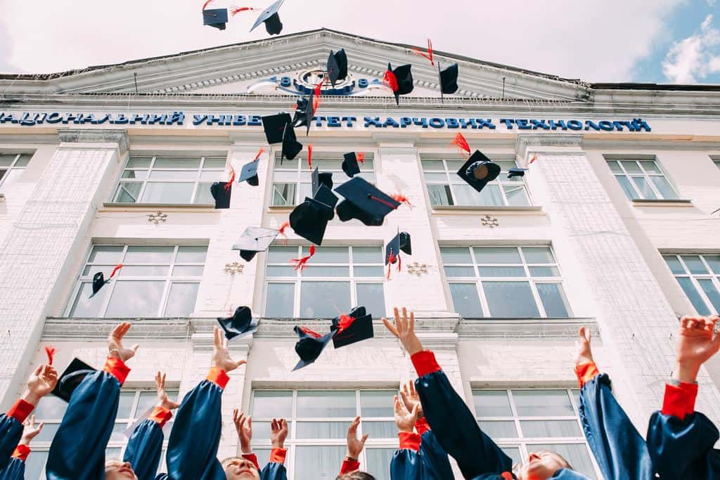 Graduation ceremony with students throwing their cap