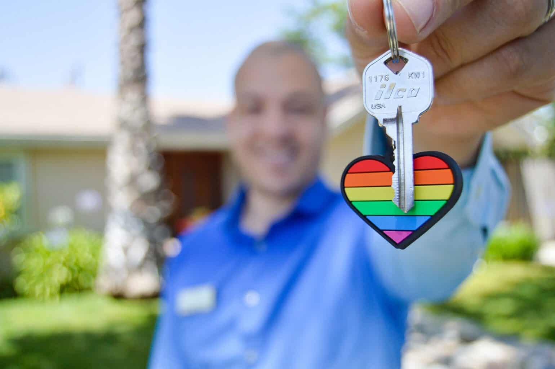 Man holding a heart keychain