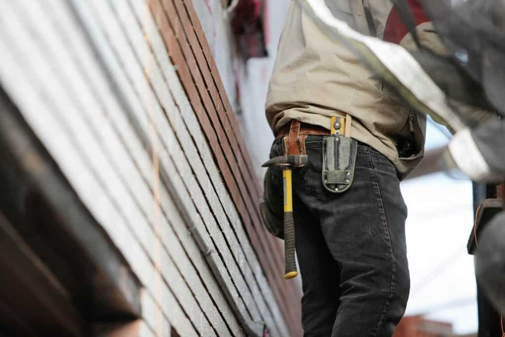 Carpenter with a harmer on his belt
