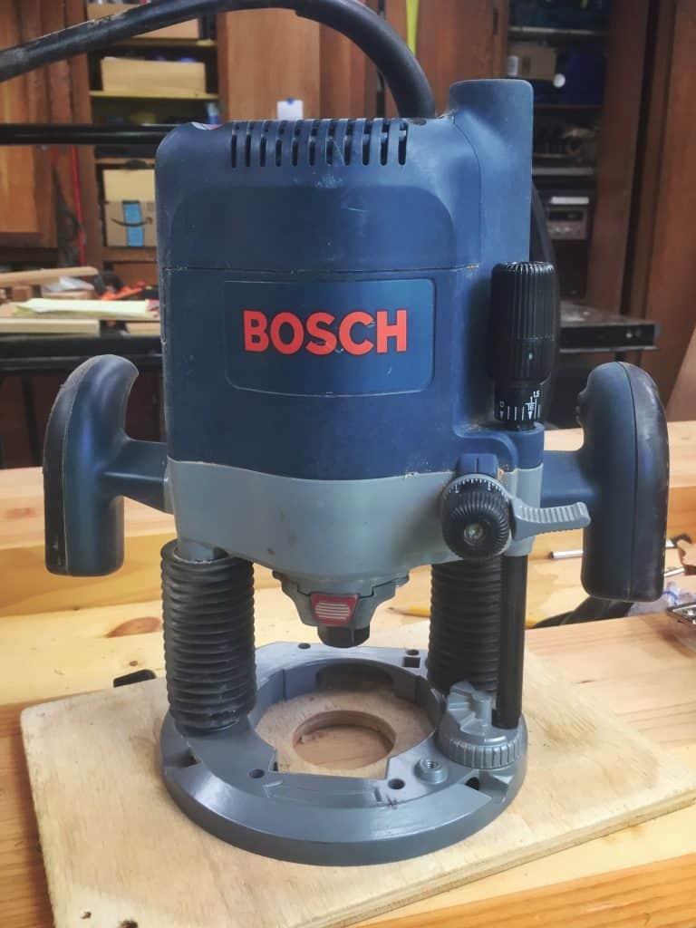 A blue Bosch plunge router
