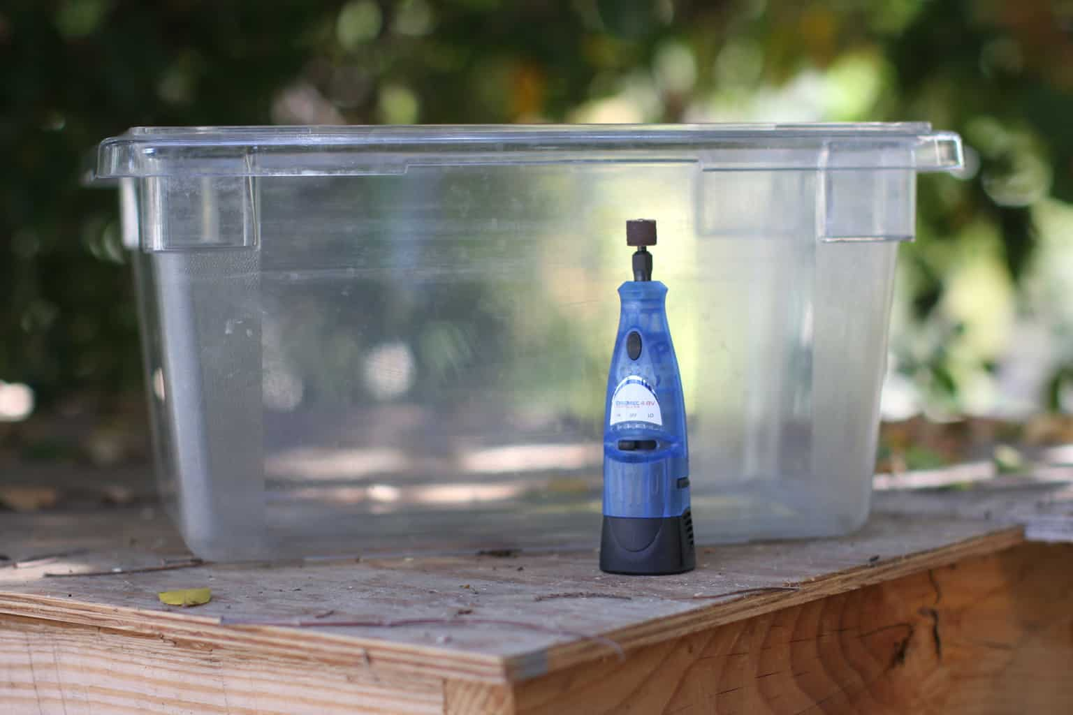 Hard plastic container with a cutting tool