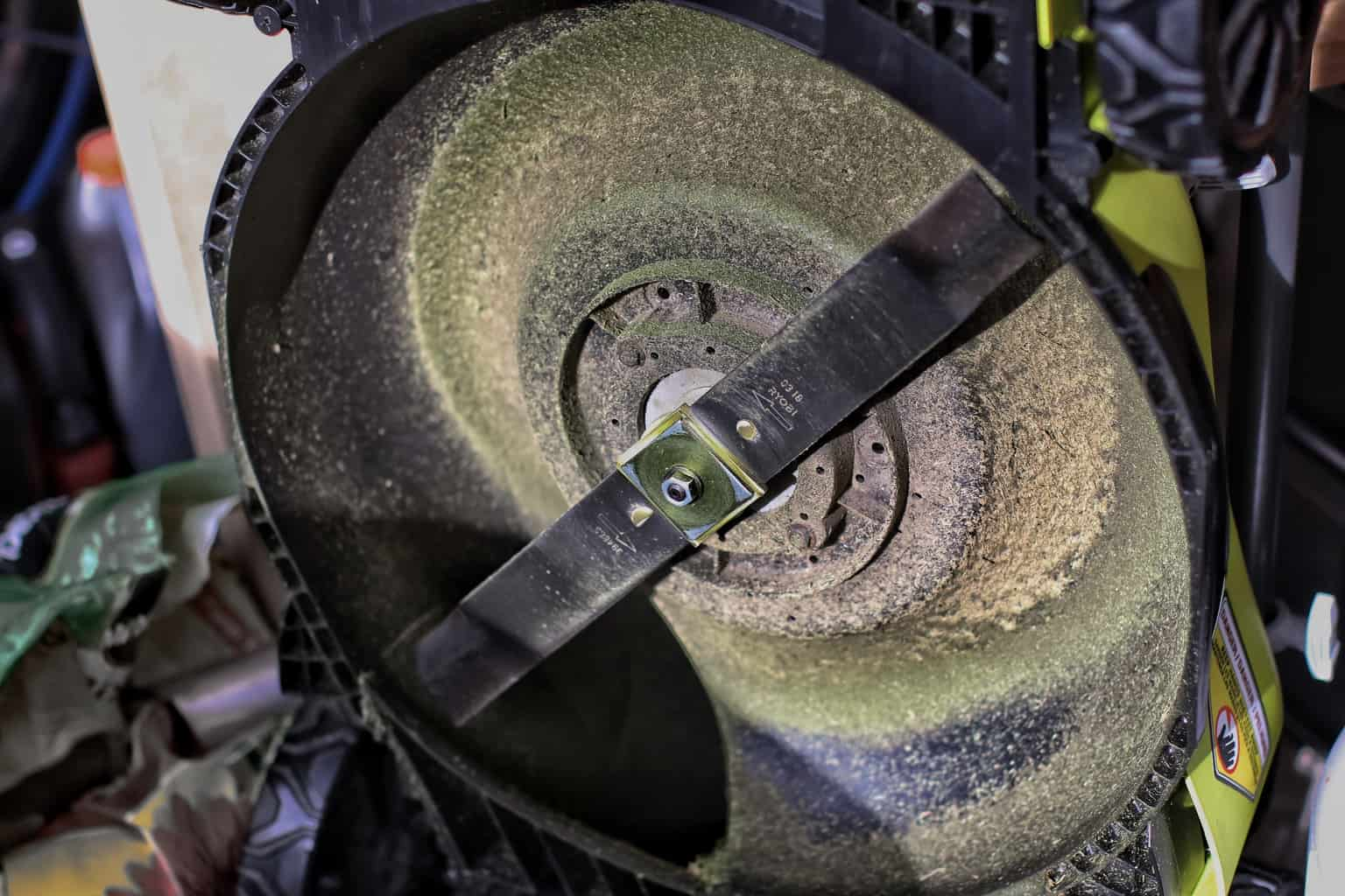 A close up of the blade of a lawn mower