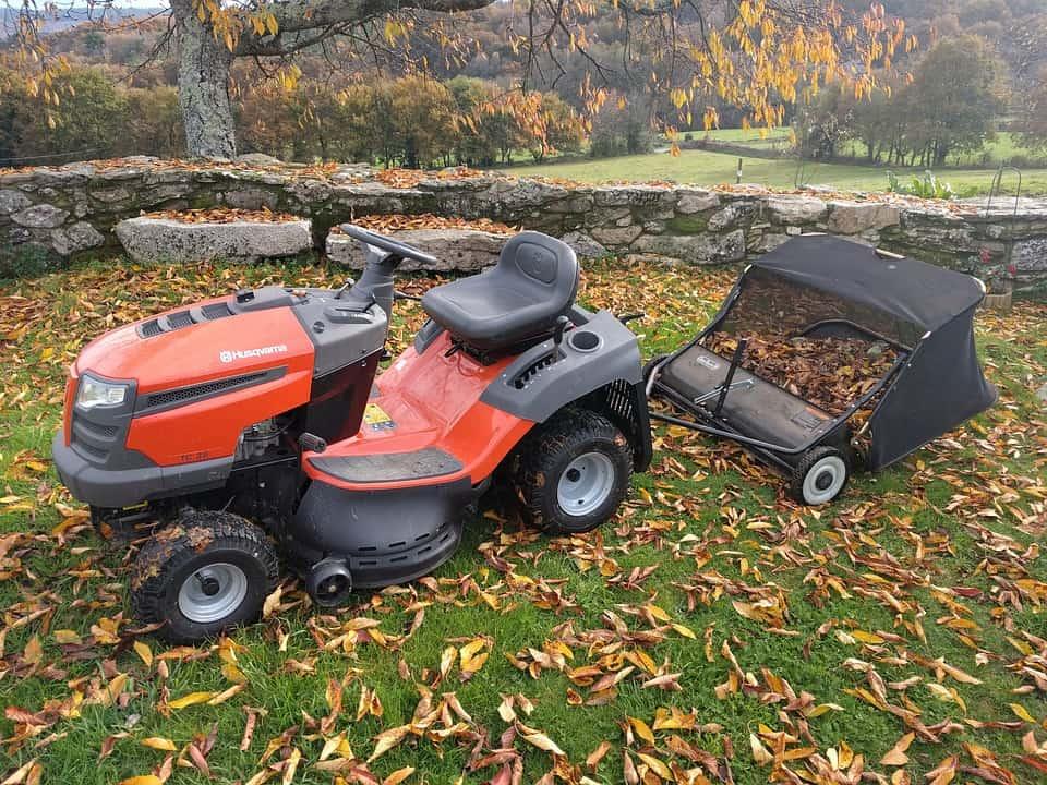 Lawn tractor in a yard full of fallen leaves