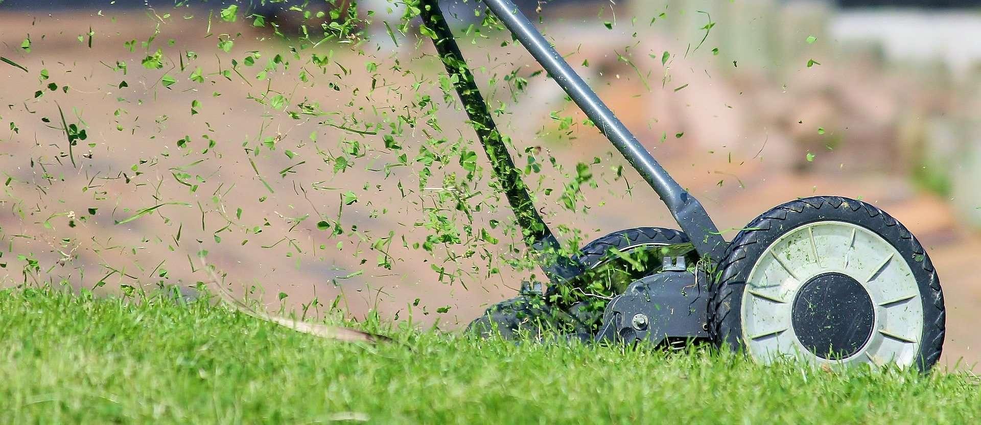A lawn mower with a balanced blade cutting grass on a lawn