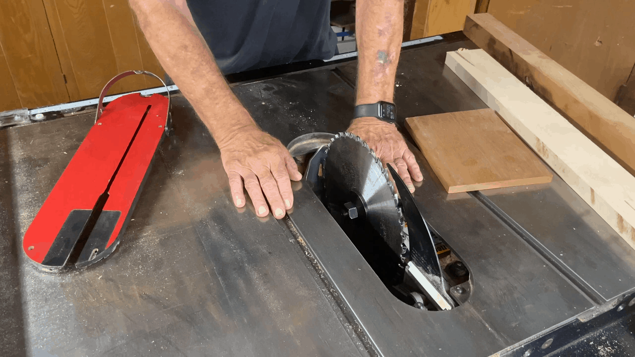 Person adjusting the table saw blades