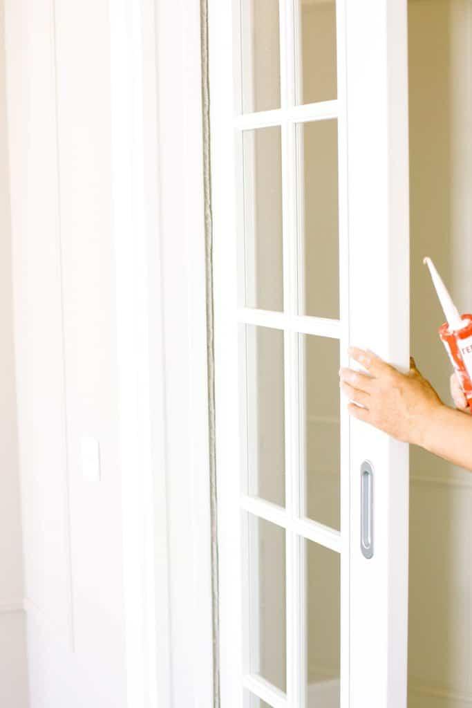 Person fixing the door
