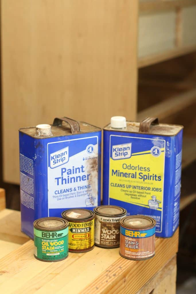 Canisters of paint thinners, mineral spirits and wood stains