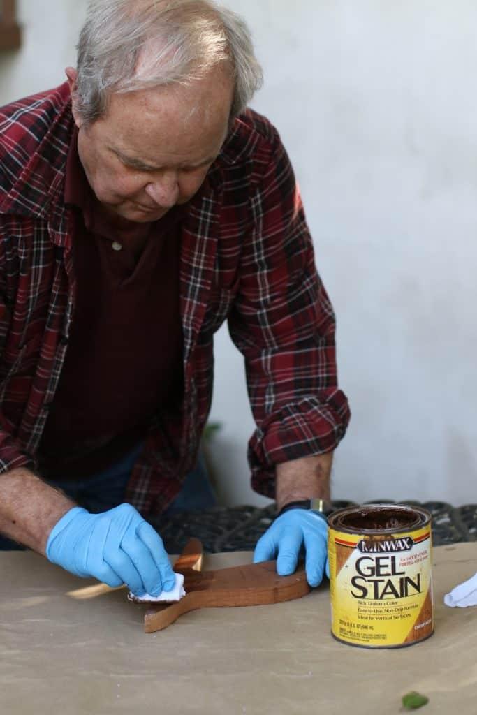 Man applying gel stain to wood