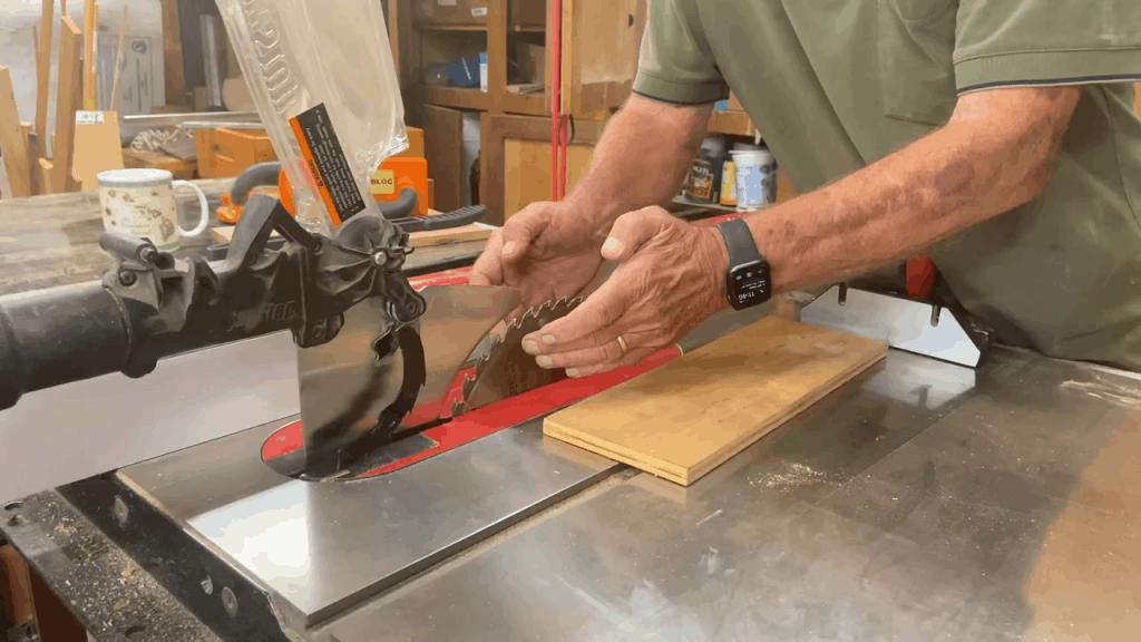 Man measuring his table saw blades