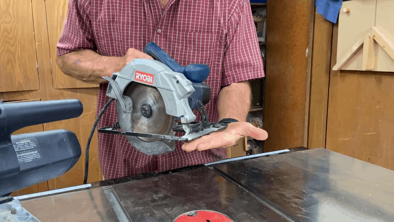Man holding a circular saw