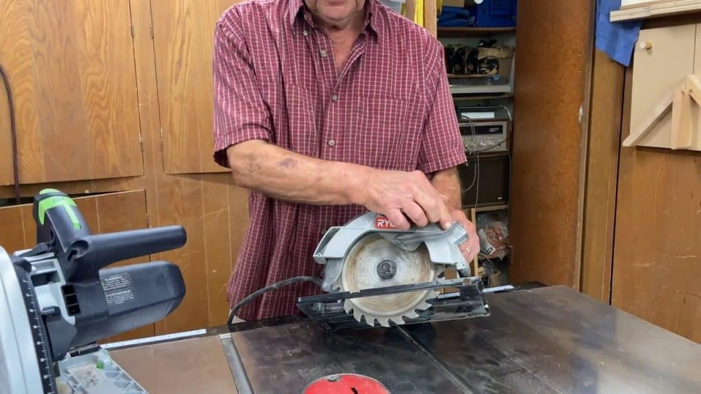 Man displaying the blades of a circular saw