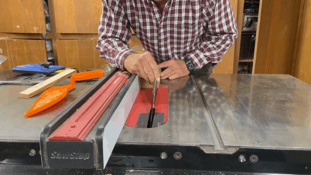 Man checking his table saw blades
