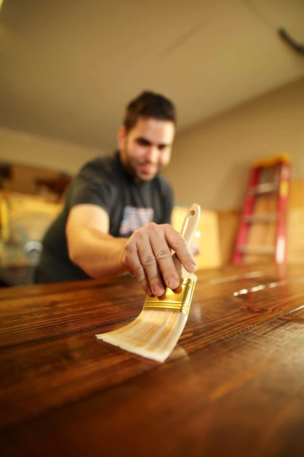 Man applying oil-based finish on wood