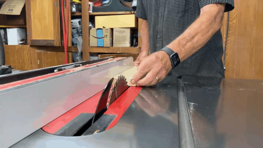Man cutting wood on a table saw
