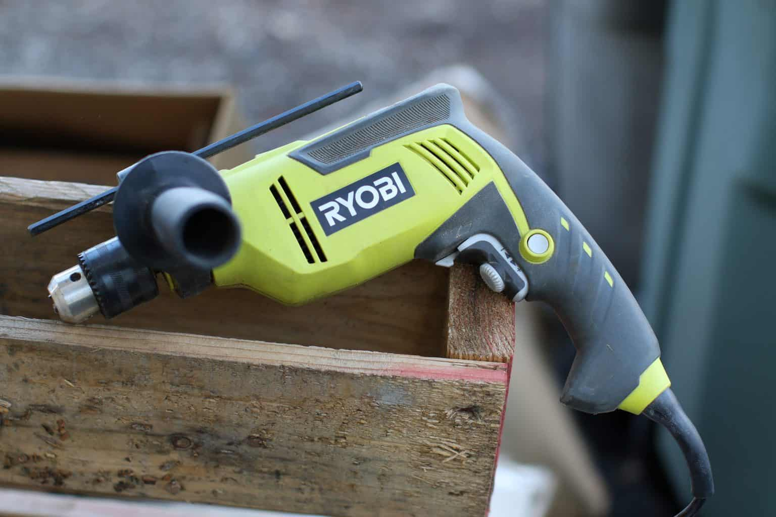 Hammer drill placed on a wooden crate