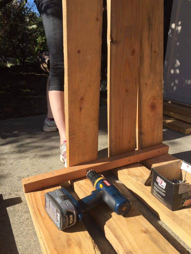 Cordless drill placed on top of a wooden pallet