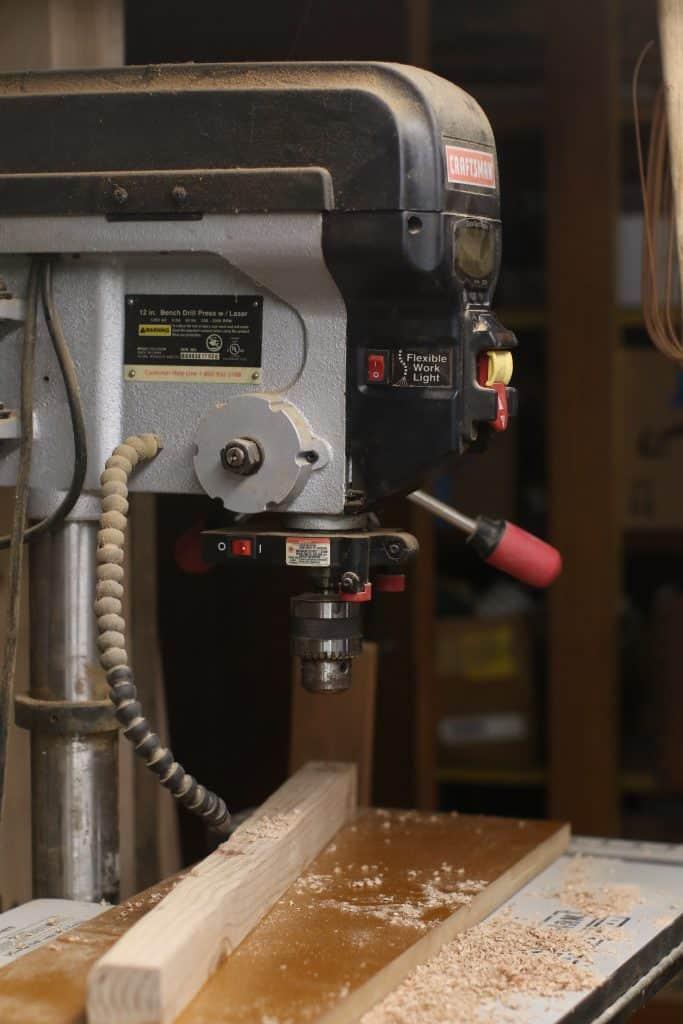 Using a drill press to cut wood