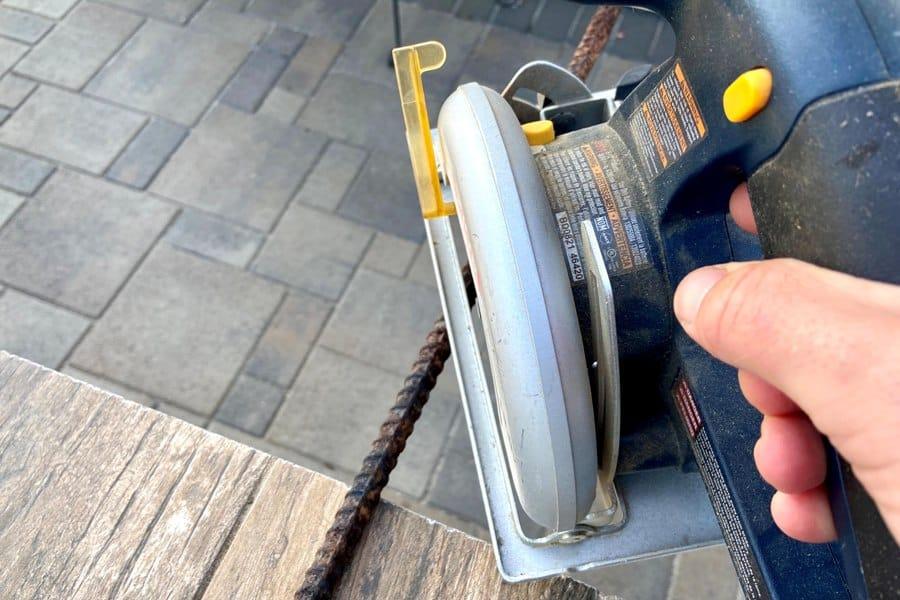 Person holding a circular saw