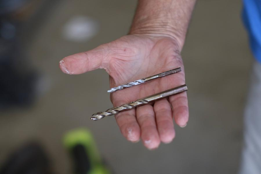 Hand holding drill bits