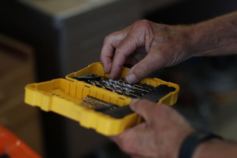 Man picking out a drill bit