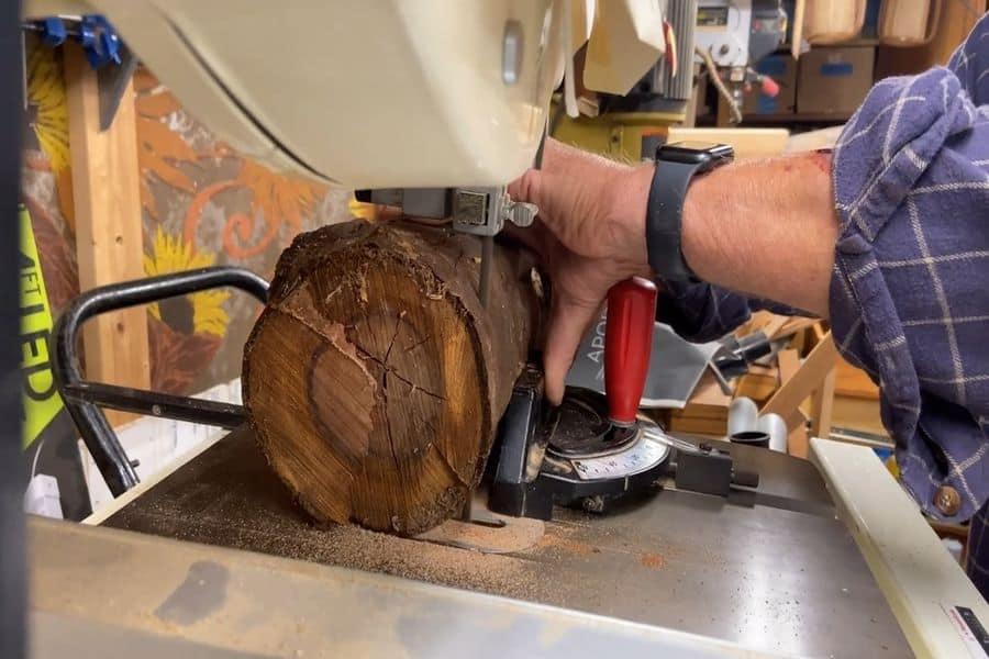 Bandsaw cutting a thick log