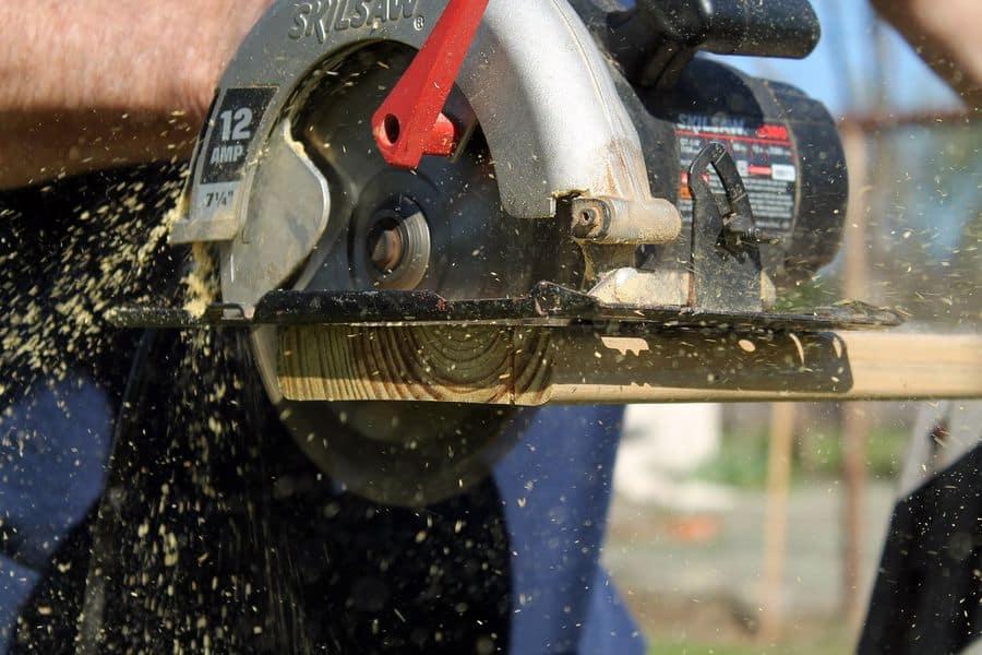 Man using a circular saw to cut wood