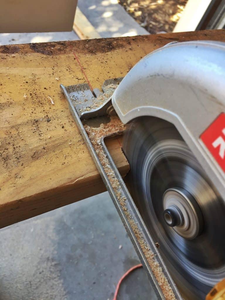 Circular saw ripping a 2x4 wood