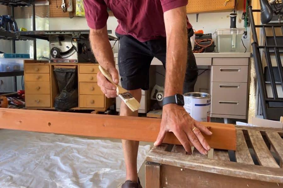 Man applying Spar varnish with a brush